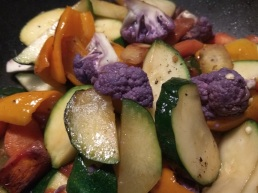 Zucchini, carrots, sweet peppers, purple cauliflower with a touch of fish sauce.
