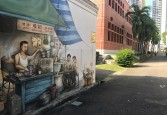 A wall mural capturing the yesteryears of the alleyways.