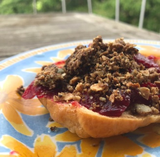 Tweaking bagel recipe as good ones are hard to come by. Topped with homemade cranberry sauce, and granola from a friend's kitchen.