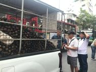 Fearless Father buying mangosteens off the back of a truck (stopped in the middle of the road) in Chinatown